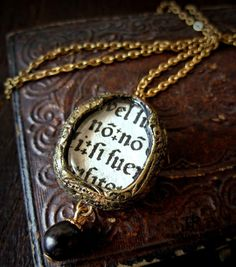 I'm not going to be able to afford this right now, but the medieval page fragment -- swoon. {Medieval Incunabula Gothic Arch Necklace by ParrishRelics on Etsy, $82.00}