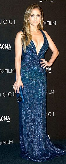 Razzle, dazzle! Jennifer Lopez twinkled in a midnight blue Gucci gown with a plunging neckline.