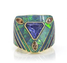 An opal, tanzanite, pinkish-brown sapphire and sugilite ring, David R Freeland Jr