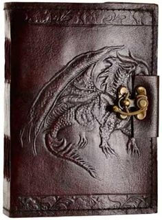 Hand tooled blank leather journal with embossed winged dragon. Border embossing may vary. Sizes vary slightly. Leather, handmade paper. 240 pages, latch closure.