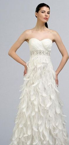 if you cut off her head the dress looks superb feather wedding