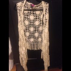 Crochet bohemian vest Lengthy cream colored crocheted vest, NEVER WORN! Bought for Coachella but it was too cold. Adorable with dresses, jeans, shorts.... Say What? Sweaters Shrugs & Ponchos