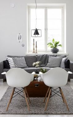 dark grey couch navy chair white walls - Google Search