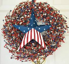 Americana Front Door Wreath is a beautiful wreath with vibrant red, white and blue berries. The wreath is made on a grapevine base.