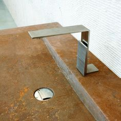 "5 mm Tap. By Rubinetterie3M, designed by Giampiero Castagnoli, Marco Fagioli, Emanuel Gargano. Compasso d'oro for the category Design for living.  Giury's comment: ""excellent result that transmits the convergence between tecnical solutions and formal and innovative language; a compact solution that points to innovative scenes"""
