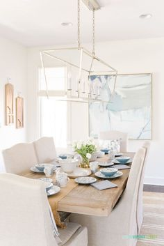 Dining area with Darlana light pendant, fabric covered dining chairs, striped jute rug, and Easter tables cape. Dining Area, Dining Chairs, Dining Rooms, Patio Dining, Lounge Chairs, Painted Coffee Tables, Spring Home, Home Decor Inspiration, Decor Ideas