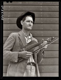 February 1942. The fiddler Nathan Drake at the Farm Security Administration's Mercer Evans relocation camp in Weslaco, Texas. Medium format safety negative by Arthur Rothstein for the FSA