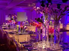 Glass tables, lucite chairs and purple lighting for a bat mitzvah in the Philadelphia suburbs {Evantine Design, Photo: Michael Branscom}