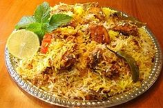 Chicken Tikka Biryani is a spicy, smoky and delicious recipe made of basmati rice and sizzling chicken chunks. Check out here:http://goo.gl/y8WHvM