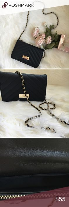 BCBG vegan cross body purse Little black Cross body purse in black with gold hardware. Strap has gold tone chain detail intertwined with black strap. 7 1/2 W x 4 1/2 2' depth. New! Authentic. 🚫trades BCBG Bags Crossbody Bags