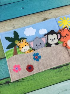 Ready for a day of jungle fun? These sweet little finger puppets are ready for play! Great for the car, quiet time, church, doctor appointments, or just when momma needs a few minutes of peace :)  This puppet book features 7 little cuties: elephant, zebra, monkey, lion, hippo, tiger, and giraffe!  Each book is individually made so please allow for some slight changes in fabric placement and design. As with all toys, please supervise play with small children for safety :)