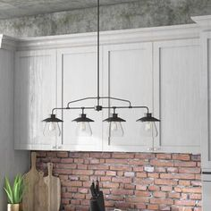 Spice up the heart of your home with a dash of industrial style with this four-light kitchen island pendant. Crafted of metal, this fixture features a generously sized 12 #style #industrial #kitchen
