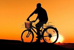 Silhouette Of Bicycle On Sunrise
