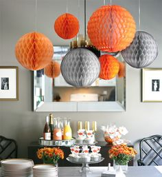 Love the juxtaposition of mod grey and orange with cheery paper globes. Such a fun table highlight!