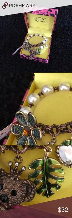 "BETSEY JOHNSON ""Koala"" Enamel Pearl BRACELET BETSEY JOHNSON ""Koala"" Enamel Pearl BRACELET ...Retired Item ...Koala done in Brown Rhinestones, Leopard Flower is Blue and Green enamel as well as the green leaf ...Beautiful heart Rhinestone and pearl charms ...Done on a Brown Metal ...Stretch bracelet has beautiful white Pearls Betsey Johnson Jewelry Bracelets"