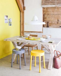 Beautiful rough wood table. Great stools and feature colour wall too.