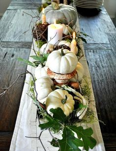 This arrangement is great. I love white pumpkins. Fall could stay around forever in my opinion.