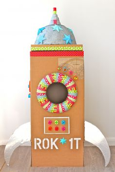 Your own version of this cardboard rocket would make a great prop/photo booth/play item for a child's outer space or alien theme birthday party.