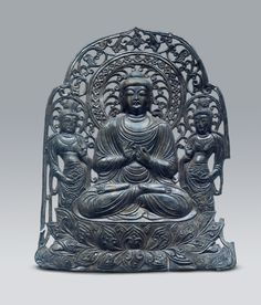 Wolji, Gyeongju / Unified Silla, Late 7th C. / H. 27.0㎝  Many Buddha statues were excavated from the site of Wolji Pond in Gyeongju, including ten Buddha plates like this one. Although its exact purpose remains unknown, the presence of a spike on the bottom suggests that it may have been fixed onto some other object. In the center, the Svadeva Buddha sits in the Padmasanam posture (lotus position) on top of an elaborate lotus flower pedestal, with his hands held in the Dharmaakra position…