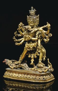 The visvajra and crescent moon in his headdress are features also seen on Kalachakra sculptures but the latter would have 24 hands. The above has four heads and 12 hands, in which he normally holds…