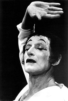 Marcel Marceau gave his first big public performance to 3000 troops after liberation of Paris in August of 1944. After the war, in 1946, he enrolled as a student in Charles Dullin's School of Dramatic Art at the Sarah Bernhardt Theatre in Paris. There his teacher was Etienne Decroux, whose other apprentice Jean-Louis Barrault hired Marcel Marceau, and cast him in the role as Arlequin. His biggest inspirations were Charlie Chaplin, Buster Keaton and Marx Brothers.