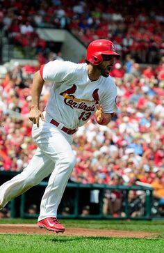 Matt Carpenter reacts after hitting an RBI triple off of A.J. Burnett of the Pittsburgh Pirates during the fifth inning...Cards won the game 6-5 in the 12th... 8-15-13