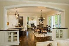 Keep the wall open between the Family, Dining Room and kitchen. I like the fact that the curved archway adds separation with intrigue but, becomes multi-functional with built-in china cabinets.