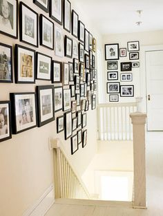 Photo Finish - same color but different sizes and styles of frames gives a unique flavor to your family wall.