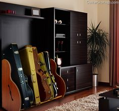 This #guitar collector keeps their living room organized thanks to the Mahogany Studio™ Deluxe Guitar Case Storage system available at http://guitarstorage.com/shop/mahogany-guitar-case-racks/