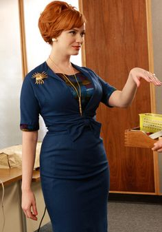 I love Joan's style and use of color. I really would love a blue outfit like this (the under shirt not so much)