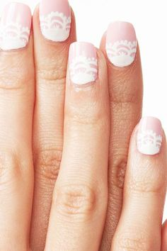 A white lace pattern over pale pink is subtle but still makes a statement.