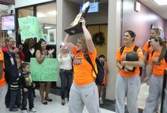 The women's volleyball team celebrates their national championship.