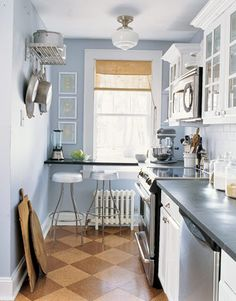 Eco-Friendly Decorating--great use of a narrow space--love the pot rack on the wall