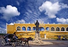 De great church Izamal was built upon de site of a Maya temple or pyramid with its striking yellow color n arches all around in Yucatan peninsula_ Southeast Mexico