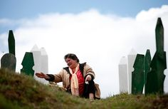 Vlasenica, Bosnia and Herzegovina: A woman visits a grave 22/4/12