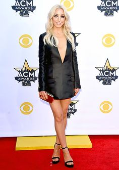 Short and sweet! Monroe chose a long-sleeved, tuxedo-style minidress, paired with a blood-red clutch and black sandals.