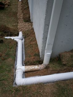 ❧ Installation in progress. Downspout extension connected to French drain.