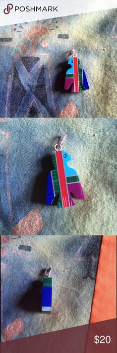 Carved Eagle Pendant Rainbow 🌈 Flight Colors Matches the earrings in my closet. Etched eyeball and claw talons. Looks like metal bars in silver tone separations Power blue green red sky blue and purple stones. Wings. Bird lovers. Small size. Add you your charm bracelet or necklace. Vintage Jewelry Necklaces