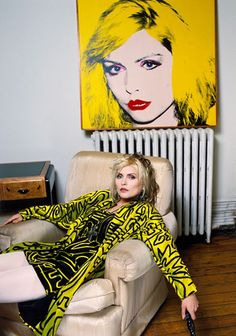 Debbie Harry wearing Stephen Sprouse in her New York apartment with Andy Warhol portrait, photographed by Brian Aris, 1988.