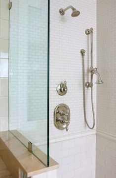 tile in shower - interesting contrast: subway tile and smaller tile. Must have hand held as well as fixed rain shower head.