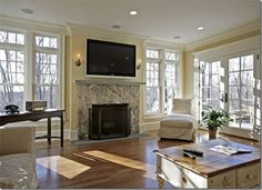 Family room - fireplace + windows + french doors