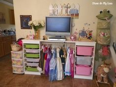 Dress ups hanging storage. Have to do this in Kinah's and Lydiah's room!