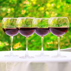 These engraved red wine glasses are sure to draw attention. Sold as a set of four, these high-quality glasses have large fluted bowls and long tapered stems. Each glass comes custom engraved, and they are dishwasher safe for your convenience.