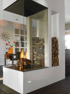 Refined contrast in open space living as glass encases the minimalist, striking fireplace,  designed by architect Jenny Frigren.  Dark, Light, Glass