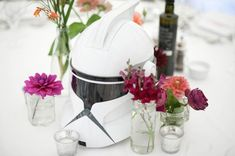 Love the idea of mixing helmets and props with elegant table settings and flowers!  www.vivaweddingphotography.com