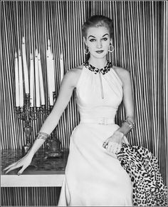 Sunny Harnett in pale-beige linen dinner dress with leopard collar that becomes crisscrossing straps in the back by Herbert Sondheim, photo by Clifford Coffin, Vogue December 1952