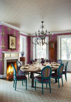 Pink dining room in a home in San Francisco by designer Steven Favreau - combines gold foil wallpaper on ceiling, gold foil accent wallpaper on walls and gold leaf on mantel.