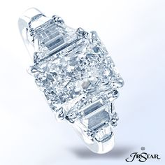 Style 7312 Platinum and diamond ring classically designed with a 3.20 ct radiant diamond center embraced by perfectly matched trapezoid and baguette diamonds.
