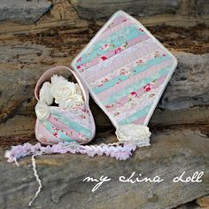 How sweet are these! My China Doll, Katy used the Darling Daisy Bag and Flutterby Kite pattern by Molly and Mama from One Thimble Issue 12 to sew these!