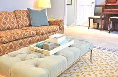 turn an ikea coffee table into a tufted ottoman!